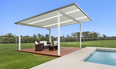 Fresstanding steel-frame roof structure for pool area.